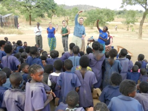 Jack teaching at the village school assembly.